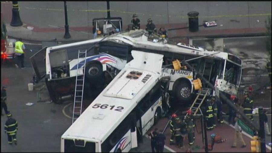 """A witness of the bus crash said there were """"bodies laying everywhere"""". Firefighters were helping passengers to exit the bus, while medical officials treated those injured. Image Credit: Scoopnest"""