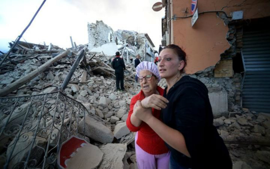 Residents react to the latest earthquake to hit Italy. Mother and daughter watch in terror how most buildings collapsed. Image Credit: Telegraph