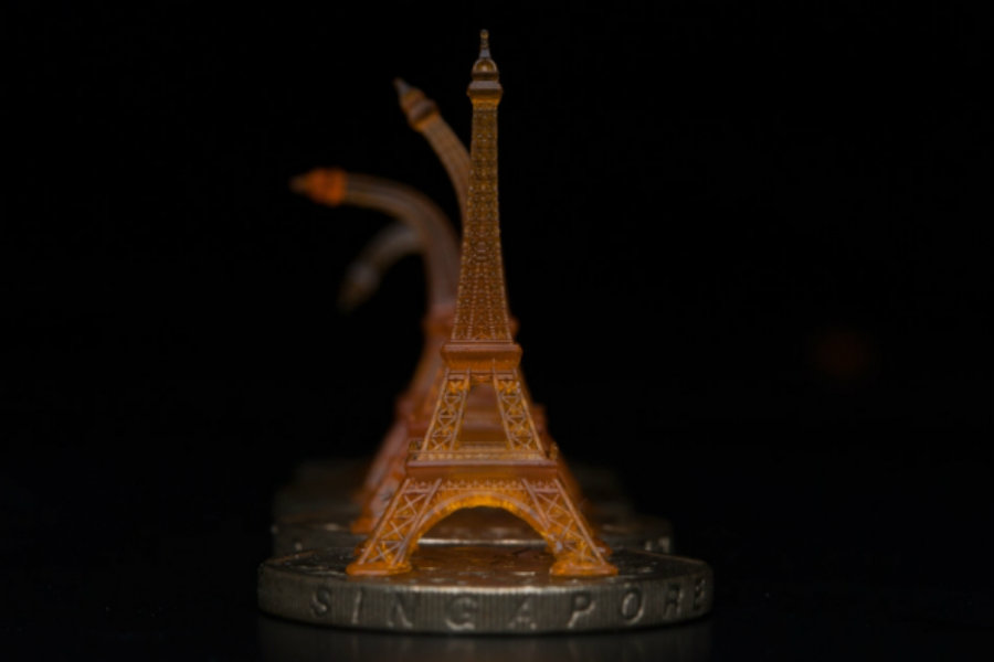 A 3D-printed replica of an Eiffel Tower goes back to its original form after being deformed. Image Credit: MIT News
