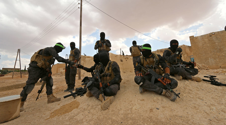 Syria Democratic Forces fighters take positions as they await U.S.-led airstrikes on ISIS strongholds. Image Credit: RT