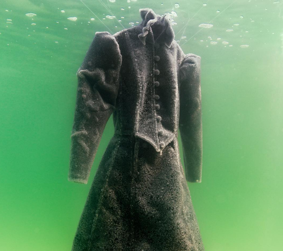 Artist submerges death robe at the Dead Sea