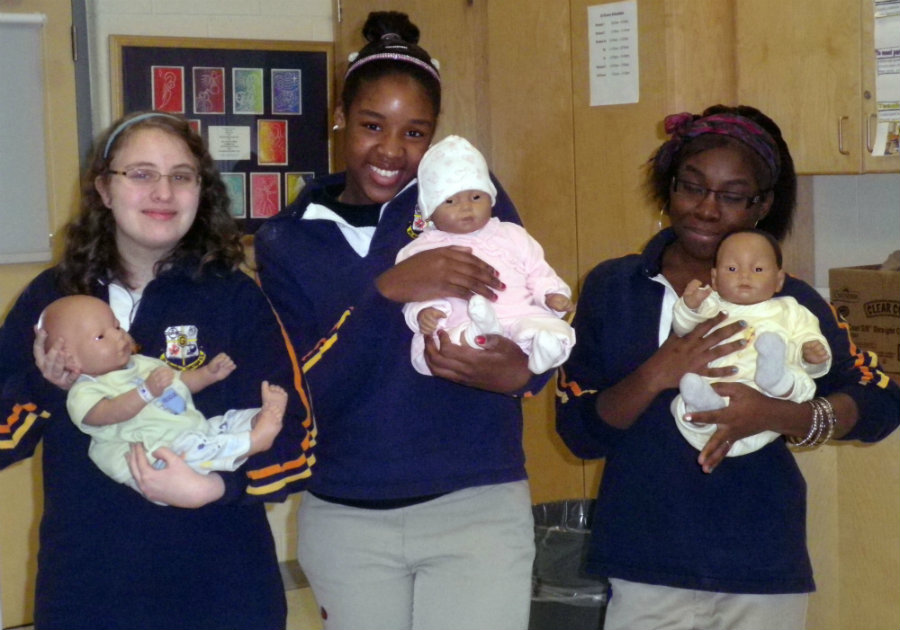 According to the study, taking care of the robot baby for a weekend could make teenage girls enjoy the challenge and the attention that comes with it. Photo credit: St. Aloysius Gonzaga Secondary School