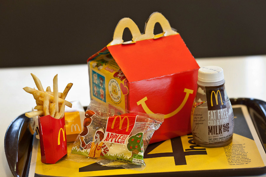 The initiative was highly criticized since it mixed in the same Happy Meal Box a fitness tracker alongside chicken nuggets, burgers, and fries. Photo credit: Cupure