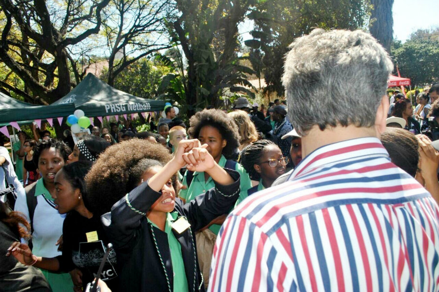 "South African students at Pretoria High School for Girls protested against a hair policy that makes them ""tidy"" their hair when they choose to wear it naturally in afros and sends them to detention if they refuse. Photo credit: Twitter / Lennoxbacela / The Cut"