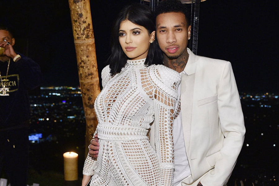 Rumors about engagement between Kylie Jenner and the rapper Tyga began when people spotted a shiny ring in Kylie's hand, which she has been using for a few days. Photo credit: In Touch Weekly