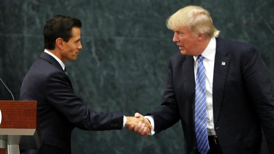 Trump flew to Mexico to meet with President Enrique Peña Nieto. Photo credit: AP Photo / Dario Lopez-Mills / Quartz