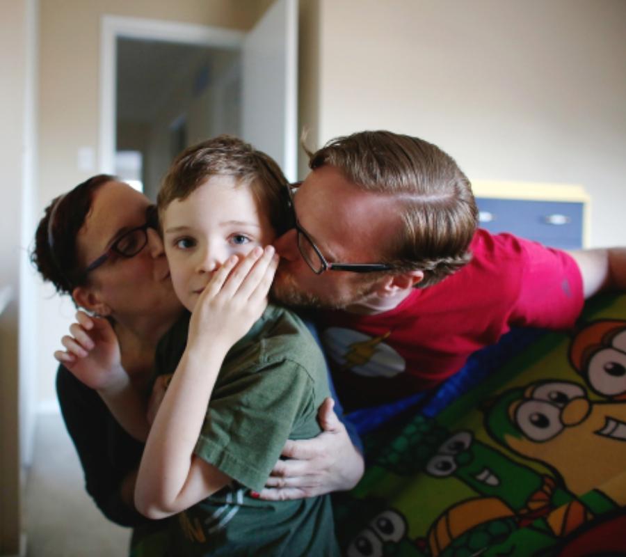 Boy, parents, autism