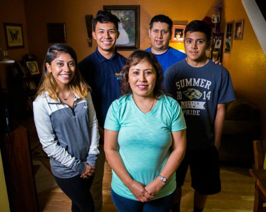 Imelda Vaquera-Torres (center), breast cancer survivor, stands with her family. Photo credit: Ashley Landis, Staff Photographer / Dallas News