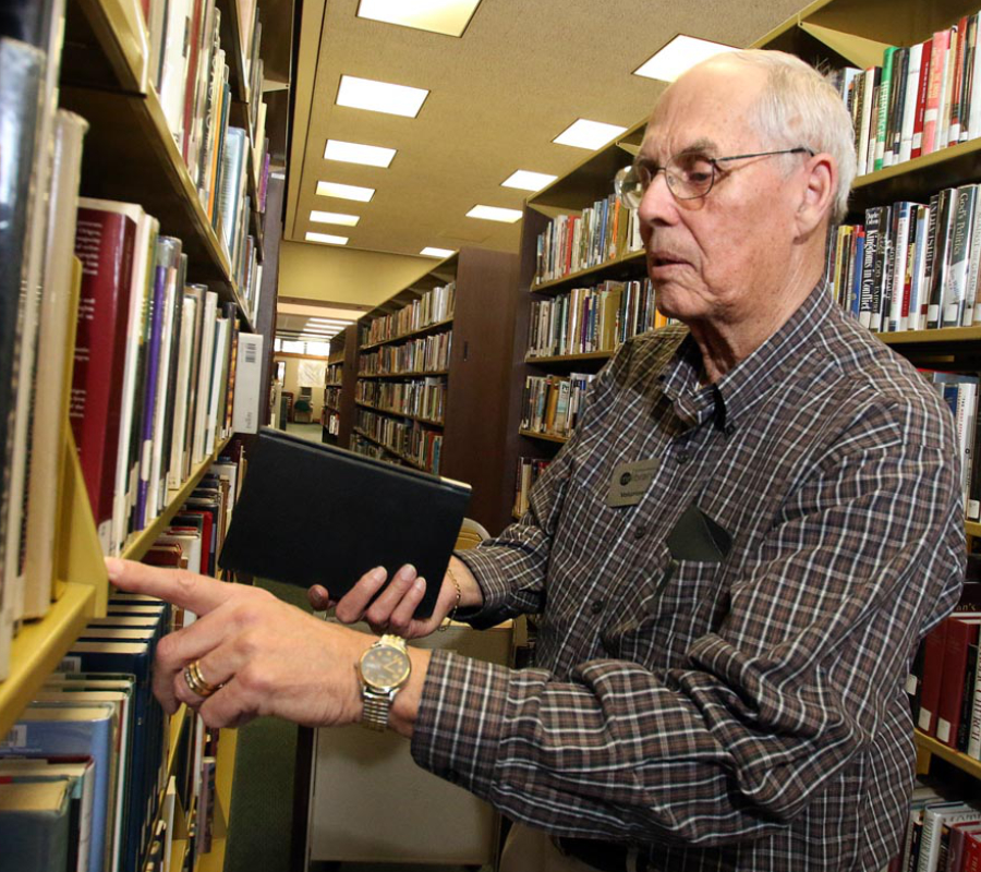 Elderly adult in a library