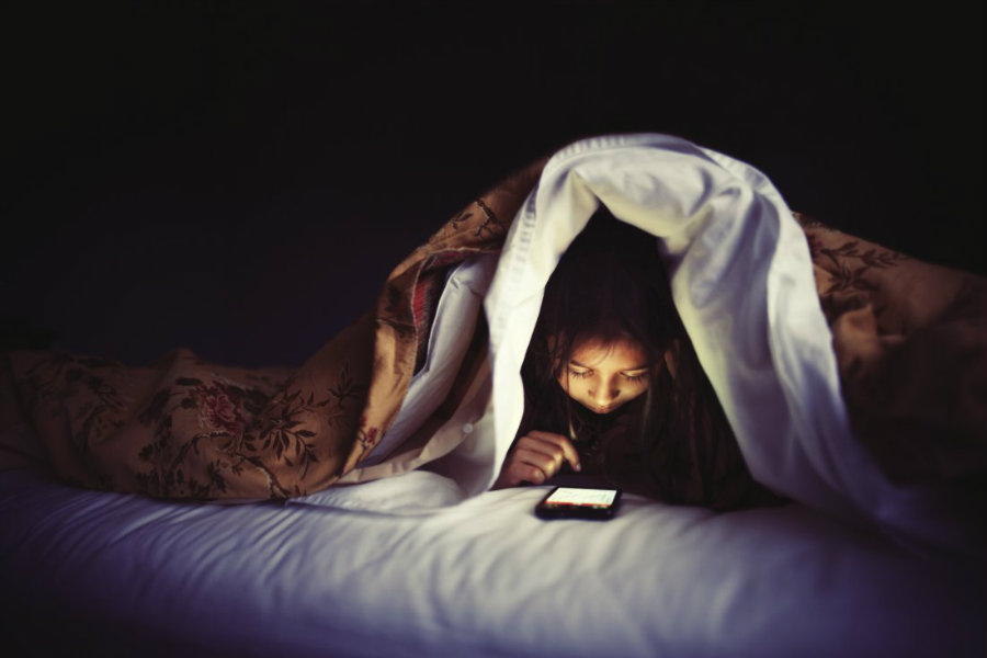 Children who used devices in their bedroom before going to sleep were more than twice vulnerable to not getting enough sleep. Photo credit: Getty Images / Time