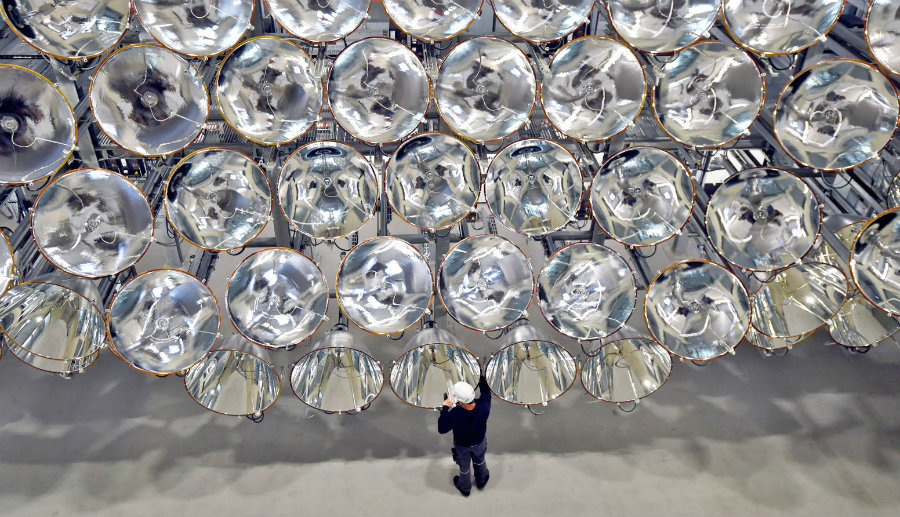 Synlight resides in Juelich, Germany, and it is a 45-feet-high honeycomb-shaped array of 149 xenon lamps. Image credit: Barcroft Media via Getty Images / Engadget
