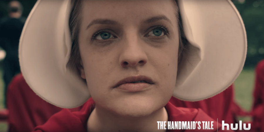The Handmaid'sTale is a dystopian novel that narrates the story of Offred, a handmaiden living in a patriarchal and totalitarian America. Image credit: Hulu via Youtube / MPR News