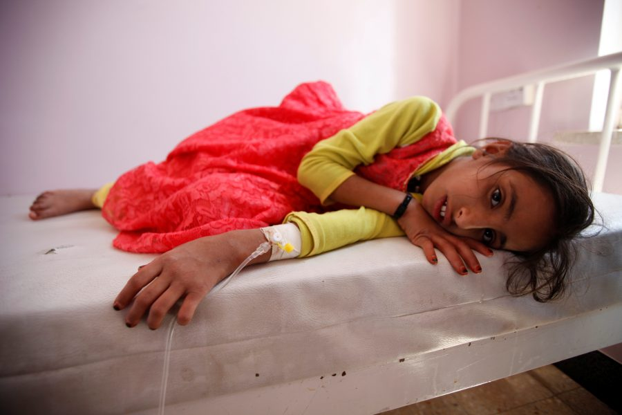 Girl lies on a bed at a hospital where she is receiving treatment for cholera amid confirmation by the UNICEF and the World Health Organization of an outbreak of the epidemic in Sanaa, the capital of Yemen