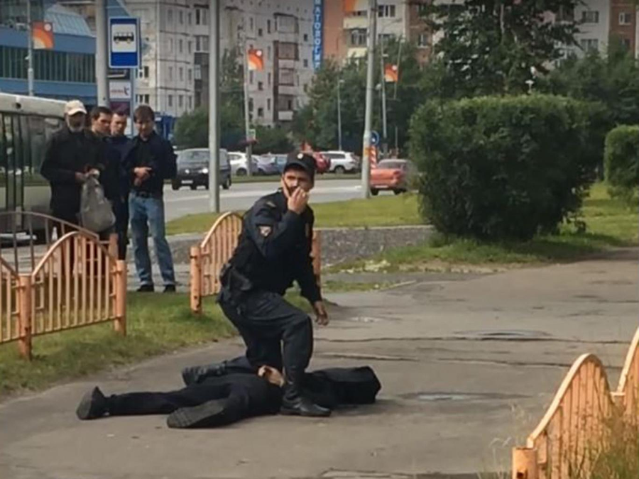 Surgut officers after the attack. Image Credit: Вася Аллибабаевич / The Independent