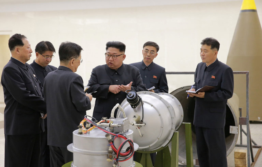 Kim Jong-un, inspecting a missile-ready hydrogen bomb. Image Credit Korea Central News Agency