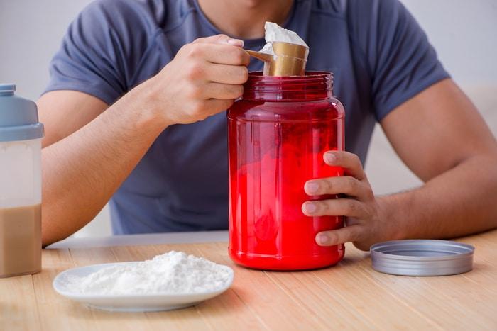 Athlete Consuming Protein Powder
