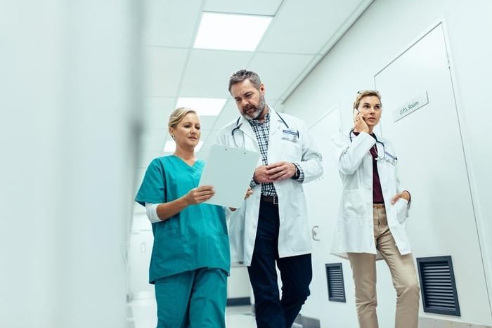 Doctors Walking in Hospital Corridor