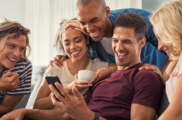 Man Showing Video On Smartphone