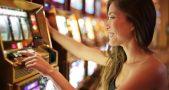 Asian Woman Playing Slot Machine