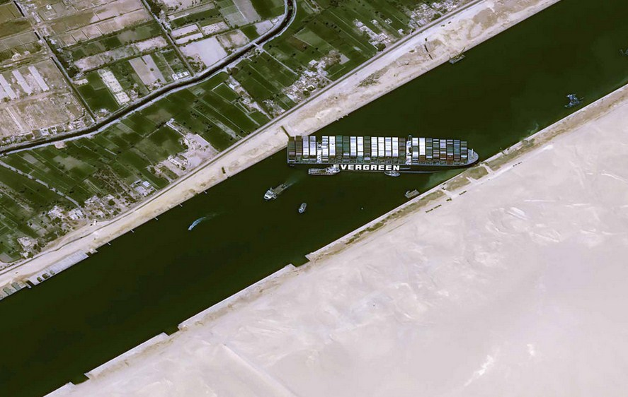 US Navy Offers To Help Re-Float Giant Container Ship Run Aground In Suez Canal